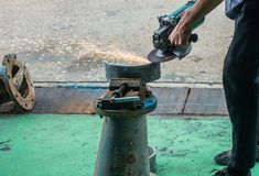 Careless worker use hand grinding without  safety gloves. Outlet generating electricity sparks Stock Images
