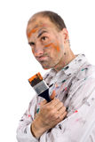 Careless young man covered in paint. Isolated on white royalty free stock photography