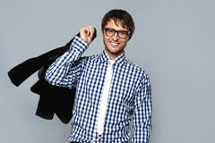 Careless young man with a jacket Stock Photography