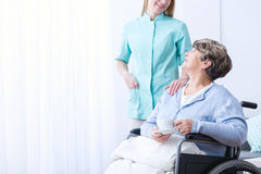 Carer helping senior woman. Carer helping senior women in rest home royalty free stock images