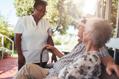 Carer looking after an elderly couple Royalty Free Stock Photography