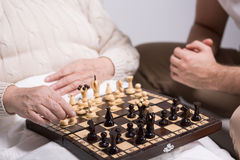Carer playing with resident. Photo of carer playing chess with rest home resident Stock Image