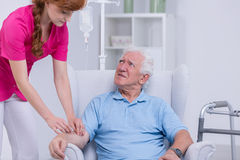 Carer and senior patient Stock Images