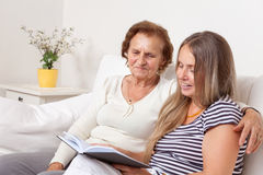 Carer spending time with an elderly woman Stock Images