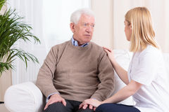 Carer supporting senior man Royalty Free Stock Photo