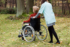 Carer on a walk with patient Royalty Free Stock Photography