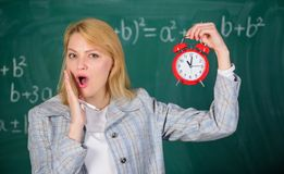 She cares about discipline. What time is it. Woman teacher hold alarm clock. Girl formal wear school lecturer. Time to. Study. Welcome teacher school year royalty free stock images