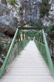 The Cares Route. A woman is crossing a bridge in the Cares Route from Asturias to Leon, Spain Stock Photography
