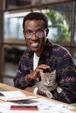 Man caressing a cat to reduce stress. Caressing a cat. A man caressing a cat to reduce stress stock photo