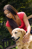 Caressing the dog Stock Photography
