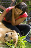 Caressing the dog Royalty Free Stock Photography