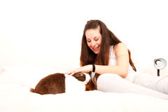 Caressing a rabbit in bed Stock Images