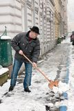 Caretaker. Snow clearance by a caretaker royalty free stock photography