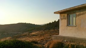 Caretakers house. Small white building for caretaker on top of mountain with mountain on background Royalty Free Stock Images