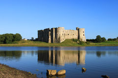 Carew Castle. And millpond in the Pembrokeshire National Park, Wales Stock Image