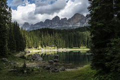 Carezza lake and Catinaccio, Dolomites Stock Photography