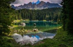 Carezza lake is a famous Unesco heritage world site in Val d`Ega, Trentino Alto-Adige, Italy. Europe stock photos