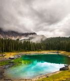 Carezza lake or Lago di Carezza, Karersee in Dolomites Alps. South Tyrol Italy Royalty Free Stock Image