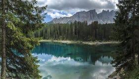 Carezza lake and Latemar, Dolomites Royalty Free Stock Images