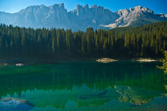 Carezza's lake and mount Latemar. Reflections in the famous lake of Carezza - Dolomites, Italy royalty free stock photos