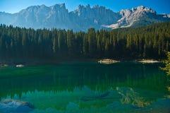 Carezza's lake and mount Latemar Royalty Free Stock Photos