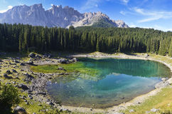 Carezza's lake and mount Latemar. Reflections in the famous lake of Carezza - Dolomites, Italy royalty free stock photo