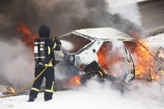 Carfire. A car burning in Sweden Royalty Free Stock Images