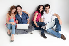 Carfree friends with laptops Stock Images