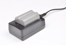Carga de la batería de la cámara Foto de archivo
