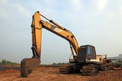 Cargador de excavador con la retroexcavadora Foto de archivo libre de regalías