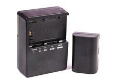Cargador y batería Foto de archivo