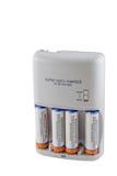 Cargador y baterías de batería de AA/AAA Foto de archivo libre de regalías