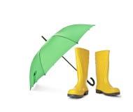 Cargadores del programa inicial de goma amarillos y paraguas verde Foto de archivo libre de regalías