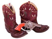 cargadores del programa inicial del cowgirl del niño de los años 50 y pistola del casquillo Imagenes de archivo