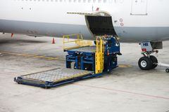 Cargo. Photo of a cargo unloading process in the airport Stock Photography