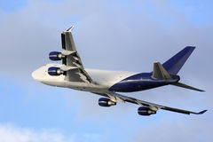 Cargo aircraft in flight Royalty Free Stock Photo