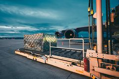 Cargo airplane at the dusk. Airport at the dusk. Loading of cargo to the freight aircraft Royalty Free Stock Photos