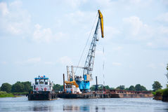 The cargo barge floats on the river Stock Images