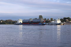 Cargo barge. Heavy goods transportation on the river Neva. Cargo barge stock photography
