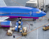 Cargo being loaded onto aircraft Royalty Free Stock Photography