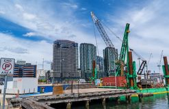 Cargo boat with crane at Docklands, Melbourne, Australia. Cargo boat with crane in front of modern buildings at Docklands, Melbourne, Australia Royalty Free Stock Photography
