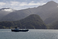 Cargo boat crossing the patagonian fjords. Cargo boat crossing the patagonian fjords, Chile Stock Photos