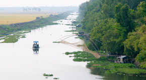 Cargo boat floating on the Mekong river Stock Photos