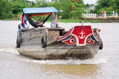 Cargo boat running on the Mekong River Royalty Free Stock Image