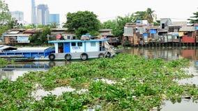 Cargo Boat and Shacks on the Saigon River - Ho Chi Minh City (Saigon) stock video