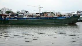 Cargo Boat and Shacks on the Saigon River - Ho Chi Minh City (Saigon) stock video footage