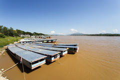 Cargo boats anchored in Mekong river ,Thailand. Royalty Free Stock Photo