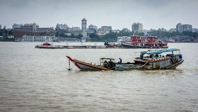 cargo boats in the Yangon river, Myanmar, may-2017 Stock Images