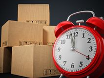Cargo boxes and alarm clock standing on black background. 3D illustration.  Stock Images