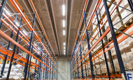 Cargo boxes storing at warehouse shelves. Logistic, storage, shipment, industry and manufacturing concept - cargo boxes storing at warehouse shelves Stock Image